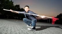 Glenn Chow with martial arts staff